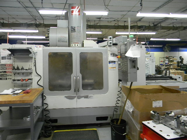 Machine 6397, Haas VF4SSAPC, Super Speed VF4, 2006, Pallet Shuttle, 12,000 RPM Spindle, 4th Axis, 24 Pocket Side Mount Tool Changer, High Speed Tool Changer, 4th Axis, Programmable Coolant Nozzle, Visual Quick Code Programming System