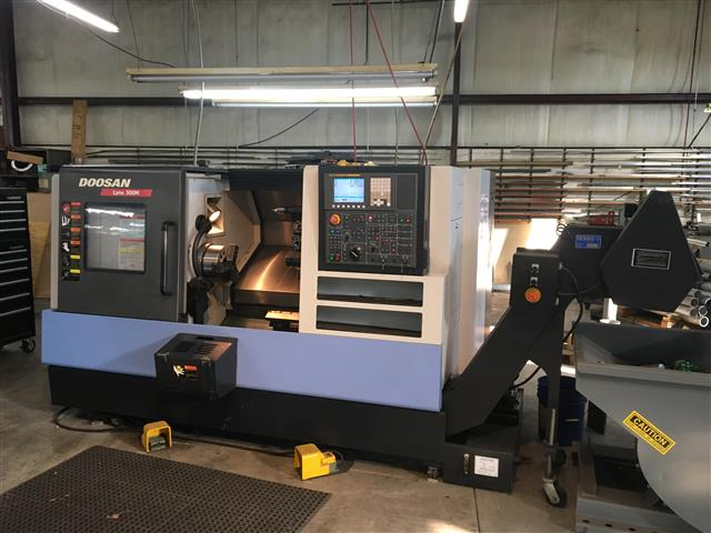 "Machine 6637, Doosan Lynx 300M, 2011, Live Tooling, 1000 hours of use, Samchully 10"" 3-Jaw Chuck, Tailstock, Parts Catcher, Chip Conveyor"