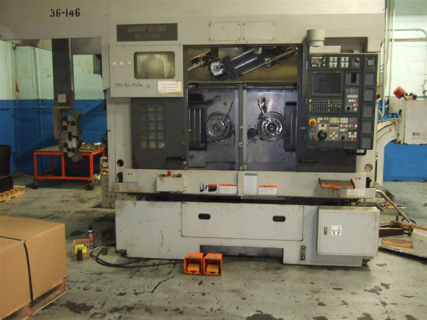 Machine 6703, Mori-Seiki RL2500 Dual Spindle 4-Axis Chuckers, 2005, Gantry Loaders, MSX-501 Controls, Chip Conveyors, Expanding Madrels, Two (2) Available